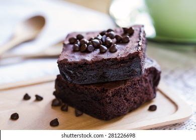 Homemade Brownies with chocolate chip by a cup of coffee