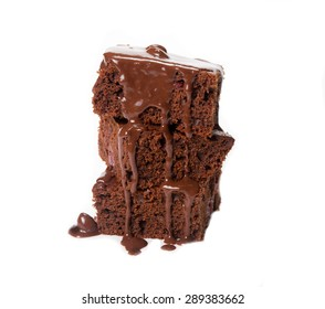 Homemade brownies with chocolate sauce isolated on a white background