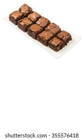 Homemade brownies in white plate over white background