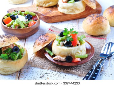 homemade buns stuffed with a salad Nicoise, with green beans, olives, tomatoes, canned tuna and boiled eggs, olive oil and lemon juice.