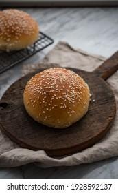 Homemade burger bun on cutting board