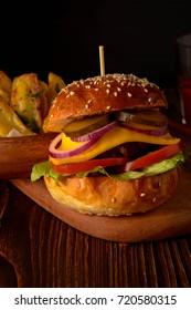 Homemade burger with fresh vegetables.