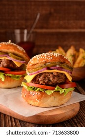 Homemade burger with fresh vegetables, tomato sauce and potatoes.