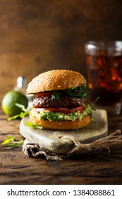 Homemade burger with guacamole dip