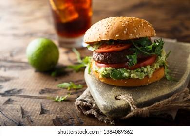 Homemade burger with guacamole dip