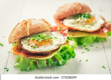 Homemade burger with lettuce, bacon and eggs