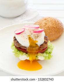 Homemade burger with a poached egg.