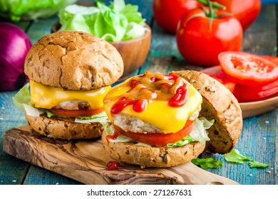homemade burgers with chicken cutlet, cheddar cheese, fresh tomatoes and lettuce