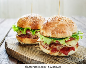 Homemade burgers on wooden background