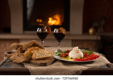 Homemade burrata cheese with homemade bread and wine