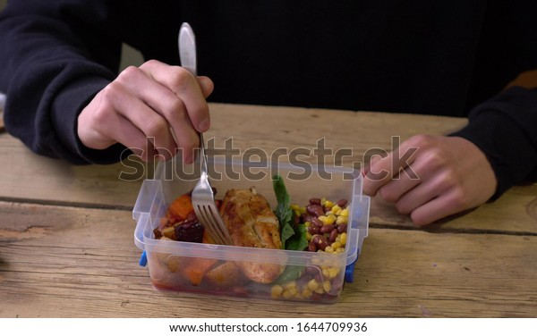 Homemade business lunch in a container in the office. Reusable Plastic lunch box with homemade food