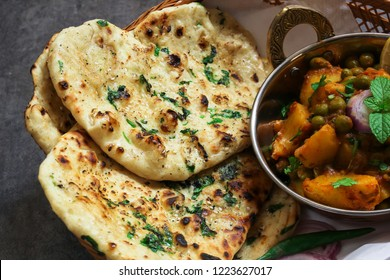 Homemade Butter Naan /Indian flat bread Kulcha served with Aloo Matar- Diwali vegetarian meal
