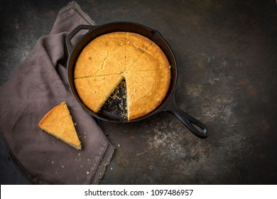 Homemade Buttermilk Cornbread in a Cast Iron Skillet on a Dark Background