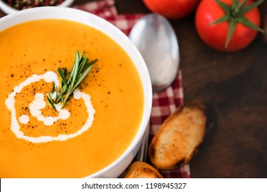 Homemade Butternut Squash Soup with Rosemary Herbs and Toppings. Hot  Pumpkin cream-soup in a white bowl