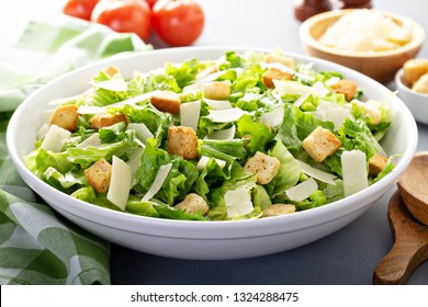 Homemade caesar salad with dressing on the side