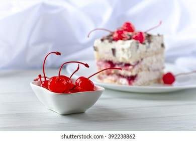 Homemade cake with cherries and chocolate , focus on foreground