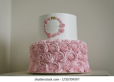 Homemade cake with flower decoration with custom inscription banner