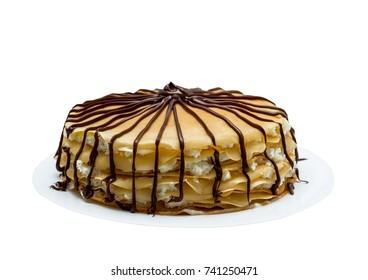 Homemade cake of pancakes, cream and chocolate, handmade, isolated on white