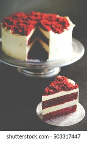 "Homemade cake ""Red Velvet"" on black background. selective focus.Vintage color tone"