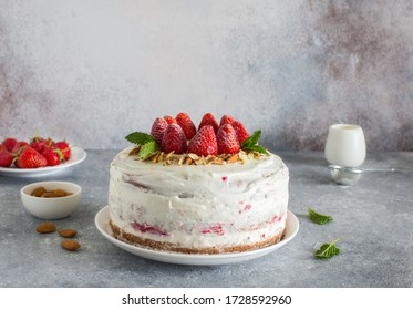 Homemade cake with strawberries, almond flakes and whippedcream close up