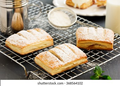Homemade cakes and puff pastry with apples and caramel.