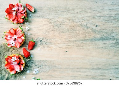 homemade cakes, strawberry cakes, organic food, summer theme ,on wooden background with space for text
