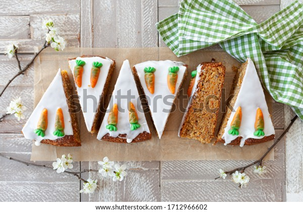 Homemade carrot cake with frosting and candy carrots