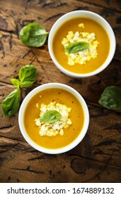 Homemade carrot soup with Feta cheese and fresh basil