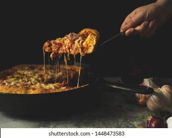 Homemade cast iron skillet cheesy pizza
