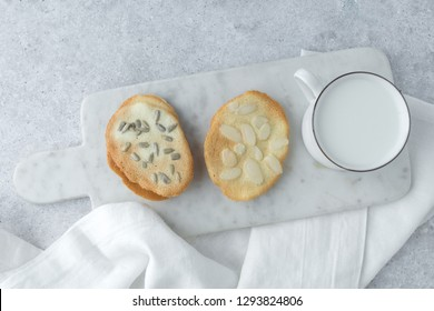 Homemade cat's tounge cookies with milk on marble background. Langues de chat.