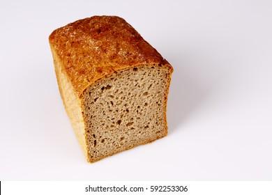 Homemade cereal bread on white, baken healthy food, breakfast