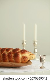 Homemade challah and candles for Shabbat