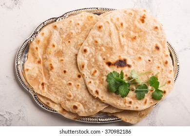 Homemade chapati (Indian bread) served with almond and masala tea