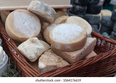 Homemade cheese in a basket on the market stall. Food
