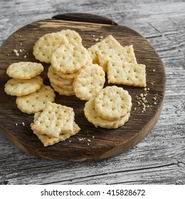 Homemade cheese cookies on a wooden rustic background