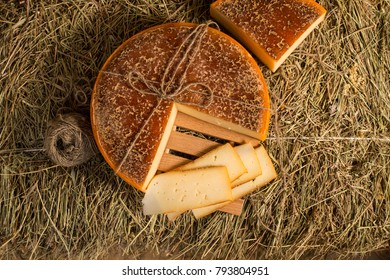 Homemade cheese presented with wooden dish