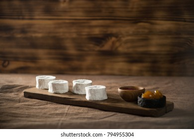 homemade cheese served on wooden dish