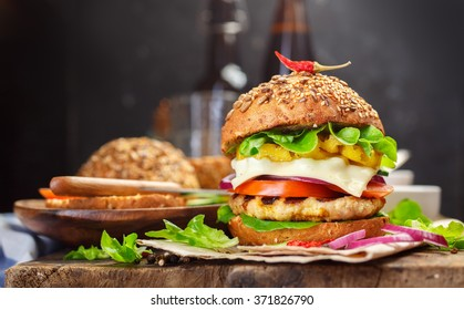 Homemade cheeseburger with Lettuce, Tomato, Onion and chili