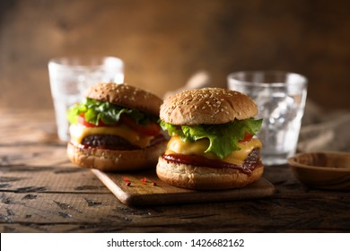 Homemade cheeseburgers with lettuce and tomato ketchup