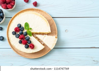 Homemade cheesecake with fresh raspberries and blueberries