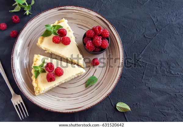 Homemade cheesecake with fresh raspberries and mint for dessert - healthy organic summer dessert pie cheesecake. Vanilla Cheese Cake.