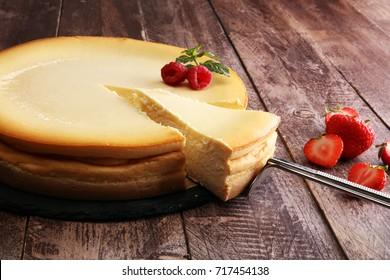 Homemade cheesecake with fresh strawberries and mint for dessert - healthy organic summer dessert pie cheesecake. Vanilla Cheese Cake.