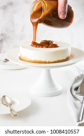 Homemade cheesecake with nuts and caramel sauce topping. Sweet cake at bakery restaurant.