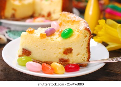 homemade cheesecake with raisins and egg shaped candies decoration for easter on wooden table