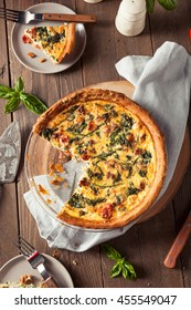 Homemade Cheesy Egg Quiche for Brunch with Spinach and Tomato