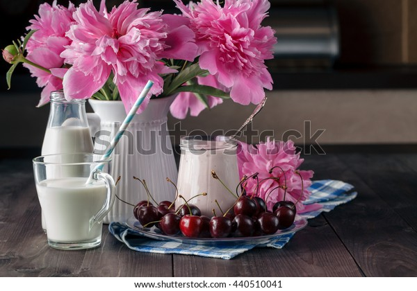 Homemade cherry yogurt in the glass cups on table