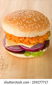 Homemade chicken burger on wooden