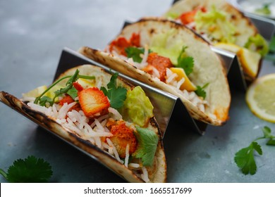 Homemade Chicken Tikka Tacos served in a metal Taco stand, selective focus
