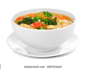 Homemade chicken vegetable soup in a white bowl with saucer. Side view isolated on a white background.