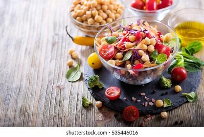 Homemade chickpea and veggies salad, diet, vegetarian, vegan food, healthy snack. Copy space background